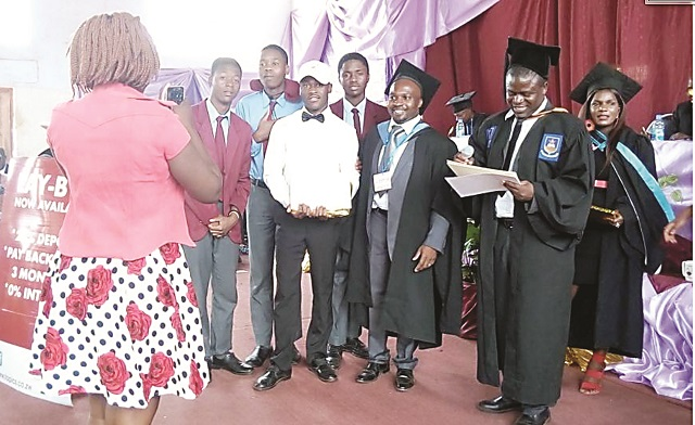 Melinkosi ( in white shirt and cap ) receives a prize during the 2016 Speech and Prize giving day